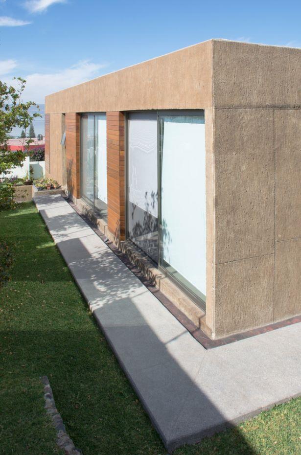 Casa cuadrada de lujo lateral