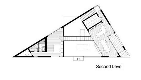 Casa de forma triangular de 2 pisos