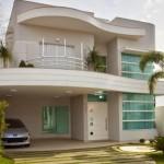 Fachada de casas de dos pisos pequeñas con curva con 10 metros de frente